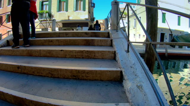 Going up the stairs of the bridge in Venice Italy video