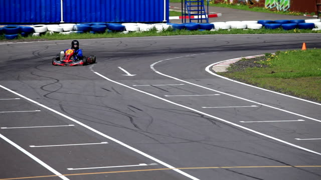 Go-kart in a curve front view racing track  Go-kart in a curve Loop ready File with sound go cart stock videos & royalty-free footage