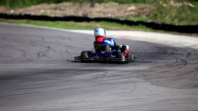 Go-kart in a curve rear view   racing track  Go-kart in a curve close to go cart stock videos & royalty-free footage