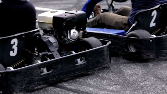HD: Go-kart racers start the race Go-cart drivers are driving hastly through race track and trying to win the rounds go cart stock videos & royalty-free footage