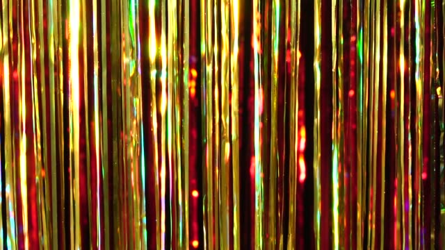 gold and red rain from tinsel. dynamic background in shining lights and sparkling particles. beautiful background with shiny glitter sparkles. festive mood. christmas or holiday theme - ghirlanda decorazione video stock e b–roll