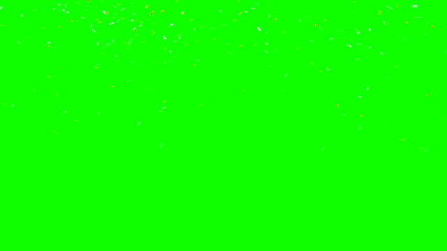 gold and silver confetti falling over green screen. - argentato video stock e b–roll