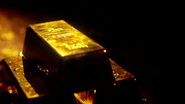 Gold bars Gold bars, coins and riches.  A scene of cluttered treasure and diamonds.  Unimaginable wealth. gold bars stock videos & royalty-free footage