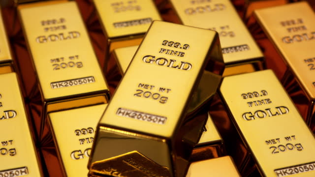 Gold bars Turning gold bars. gold bars stock videos & royalty-free footage