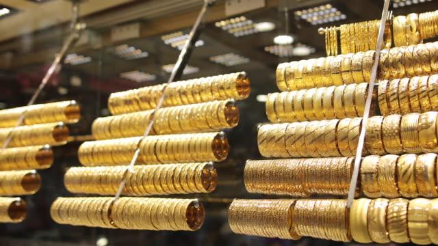 Gold bracelets in shop