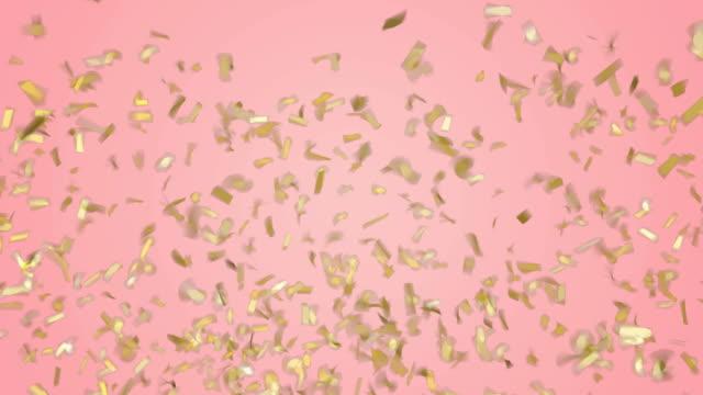 guld konfetti faller ner på pastell rosa bakgrund. grön skärm footage. - rosa bildbanksvideor och videomaterial från bakom kulisserna
