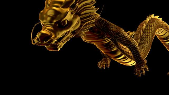 złoty smok latać w lewo i w prawo - smok postać fikcyjna filmów i materiałów b-roll