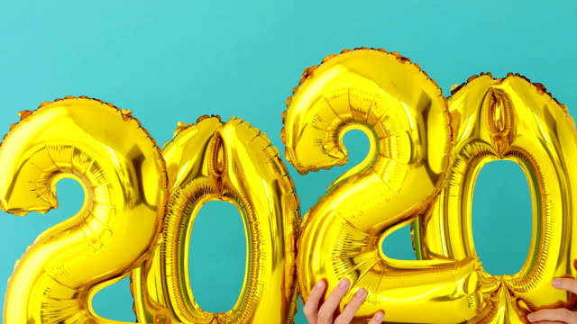 Gold foil number 2020 celebration balloon Gold foil number two thousand and twenty 2020 celebration balloon on blue background 2020 stock videos & royalty-free footage