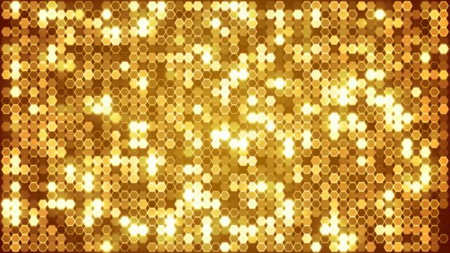 金色閃光六角抽象背景動畫。無縫回路。 - gold texture 個影片檔及 b 捲影像