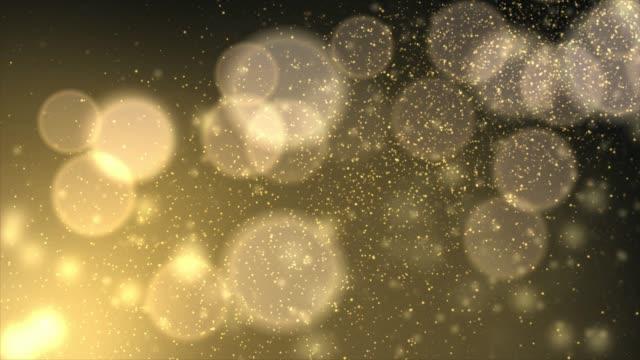 ゴールドグリッターライトと焦点が薄いボケ - 希望点の映像素材/bロール