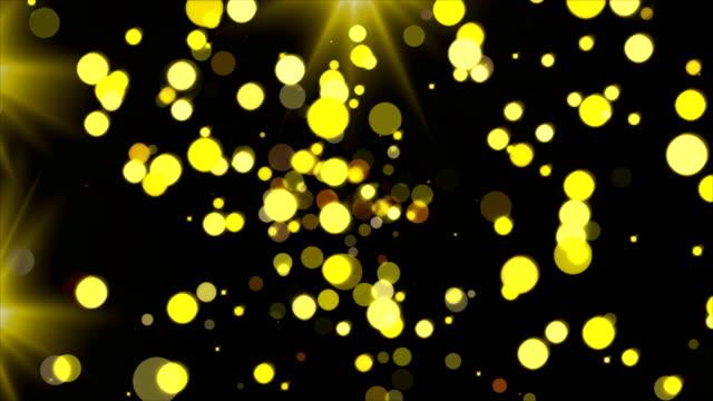 guld glittrande partiklar och blixtljus, festliga 3d återge bakgrunden, golden explosion av konfetti - wheel black background bildbanksvideor och videomaterial från bakom kulisserna