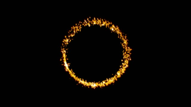 Gold glittering star dust circle of trail sparkling particles on black background. 4k video