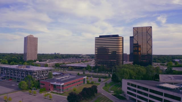 Gold Modern Office Buildings Aerial view of modern corporate office buildings in business district at dusk office park stock videos & royalty-free footage
