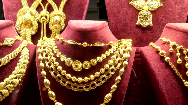 gold necklaces, chains and bracelets in a showcase. - grand bazaar video stock e b–roll