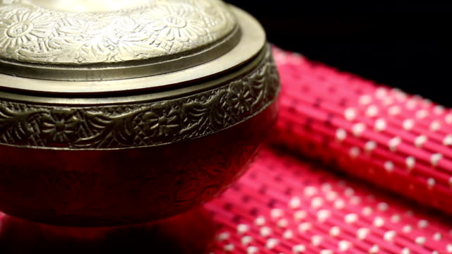 Gold Old Bowl Cup Chinese on a Red Mat Rotating video