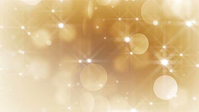 vídeos de stock e filmes b-roll de partículas de ouro cair (loopable) - glow