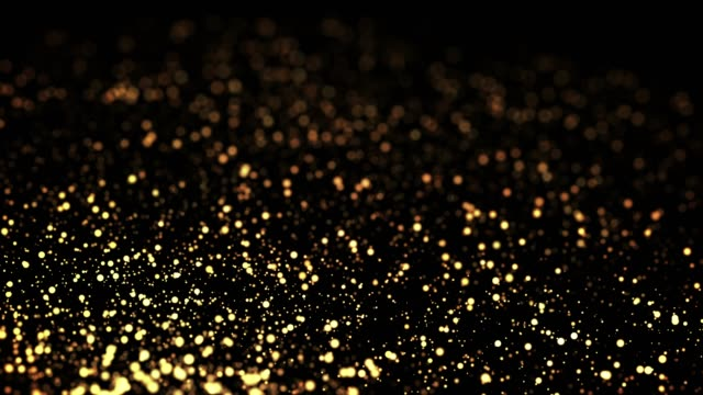 gold particles in liquid float and glisten. Background with glittering golden particles depth of field and bokeh. Luma matte to cut out glowing particles for holiday presentations. 4k 3d animation. 50 video