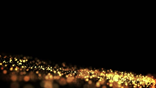 gold particles in liquid float and glisten. Background with glittering golden particles depth of field and bokeh. Luma matte to cut out glowing particles for holiday presentations. 4k 3d animation. 60 video