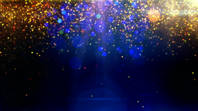 Gold particles on blue background loop Gold particles falling down on blue background with flares loop celebration background stock videos & royalty-free footage