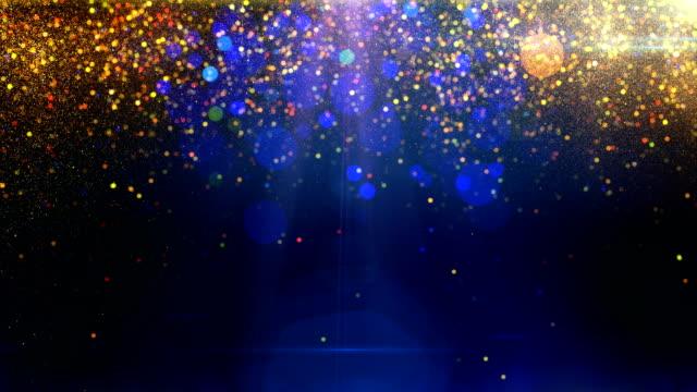 vídeos y material grabado en eventos de stock de partículas de oro en el circuito de fondo azul - holiday background