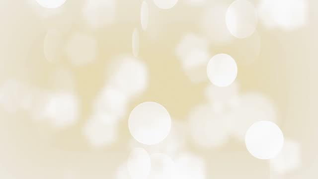 ゴールドの粒子(ループ) - キラキラ 白背景点の映像素材/bロール