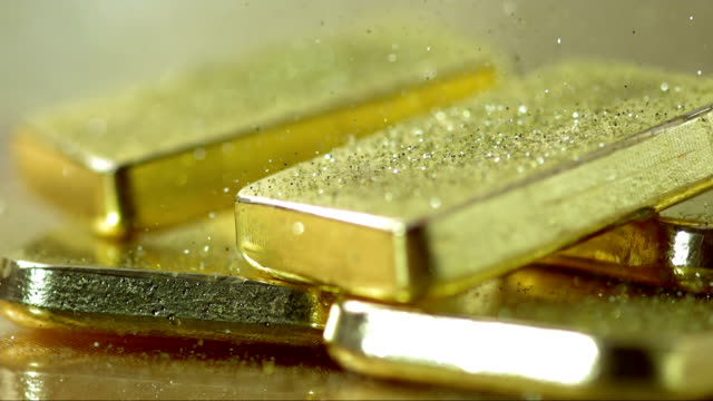 Gold Powder Falling On Ingots (Super Slow Motion) HD1080p: Super Slow Motion Close-Up shot of a gold powder falling over bars of gold. Recorded at 2000 fps. gold bars stock videos & royalty-free footage