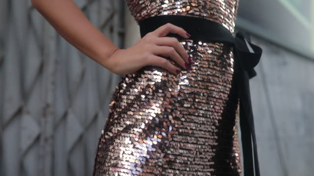 Gold sequin dress Shining gold dress with sequins on a girl sequin stock videos & royalty-free footage
