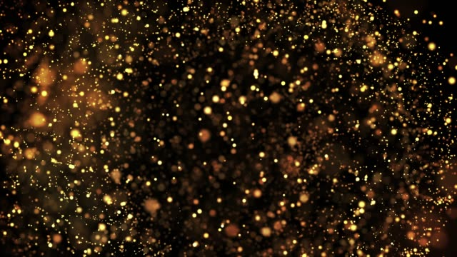 gold shiny sparkling particles move in a viscous liquid. It is bright festive background with glittering particles depth of field, bokeh and luma matte as alpha channel. 4k 3d animation v6
