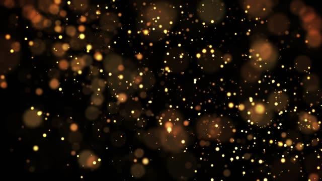 gold shiny sparkling particles move in a viscous liquid. It is bright festive background with glittering particles depth of field, bokeh and luma matte as alpha channel. 4k 3d animation v7 video