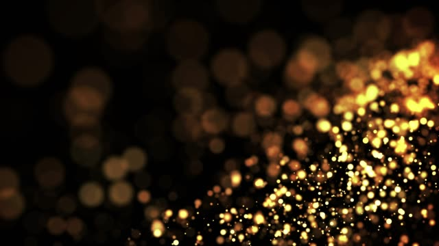 gold shiny sparkling particles move in a viscous liquid. It is bright festive background with glittering particles depth of field, bokeh and luma matte as alpha channel. 4k 3d animation v25 video