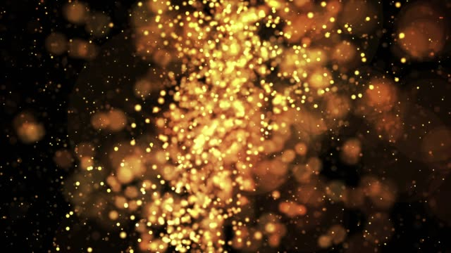 gold shiny sparkling particles move in a viscous liquid. It is bright festive background with glittering particles depth of field, bokeh and luma matte as alpha channel. 4k 3d animation v67 video