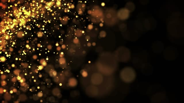 gold shiny sparkling particles move in a viscous liquid. It is bright festive background with glittering particles depth of field, bokeh and luma matte as alpha channel. 4k 3d animation v70 video