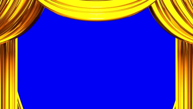 oro sipario sul blu chroma chiave - sipario video stock e b–roll