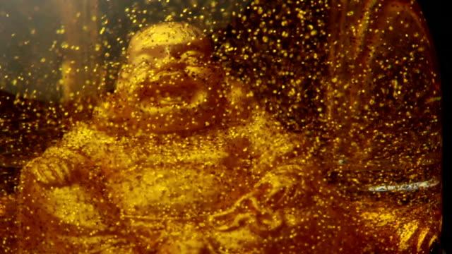 gold statue of buddha video
