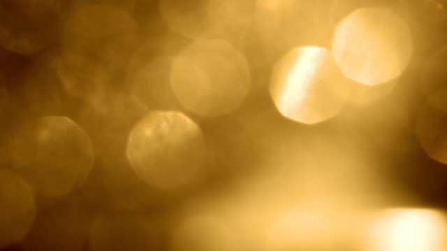 gold super soft bokeh - glitter, shimmer and shiny light leak effect - pallido video stock e b–roll