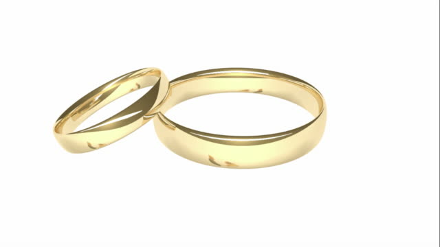 Gold Wedding Rings - Reflected Bride and Groom video