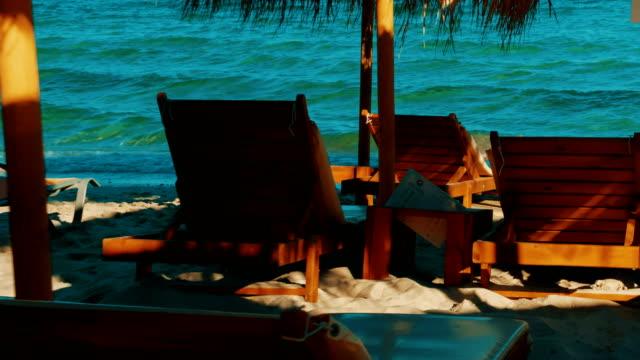 golden beach, griechische inseln, griechenland - sun chair stock-videos und b-roll-filmmaterial