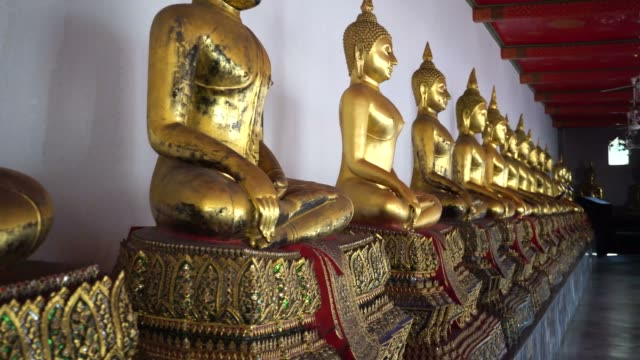 Golden Buddha Statues in the row at Wat Pho, Bangkok city, Thailand