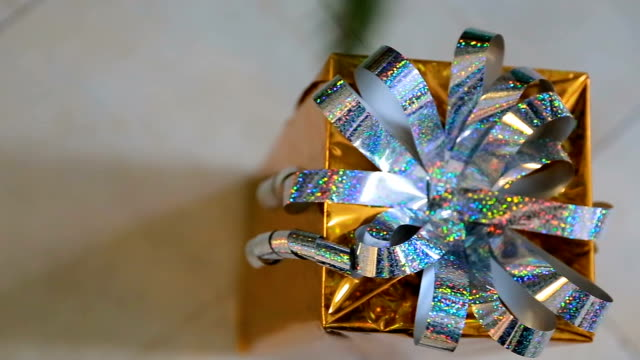 Golden christmas gift Under the Christmas Tree. Christmas gift box with nice ribbons video
