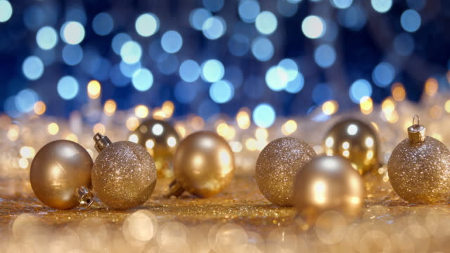 golden christmas time - decorations lights bokeh defocused blue gold - christmas decoration стоковые видео и кадры b-roll
