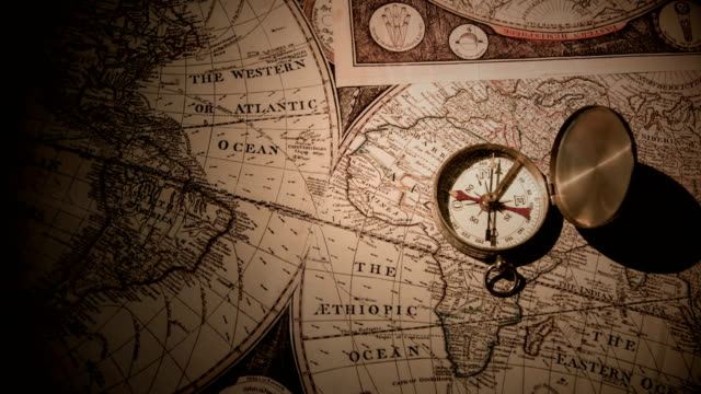 Golden Compass On Antique Map 4K Video navigational compass stock videos & royalty-free footage