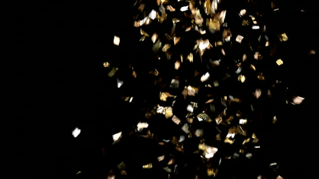 Golden confetti falling down video