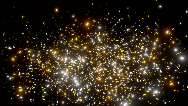 golden confetti shoots and falls down on the black screen. bright golden shimmer. 3d animation 4k - anniversario video stock e b–roll