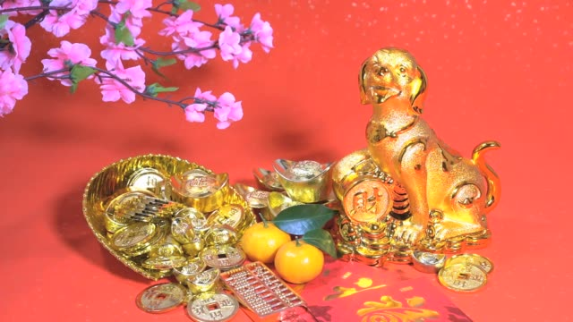 Golden dog statue on red paper
