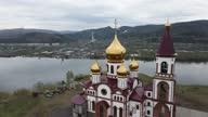 istock golden domes of the Orthodox church, a Russian church on the high bank of the Siberian river Yenisei, Krasnoyarsk, 1318953620