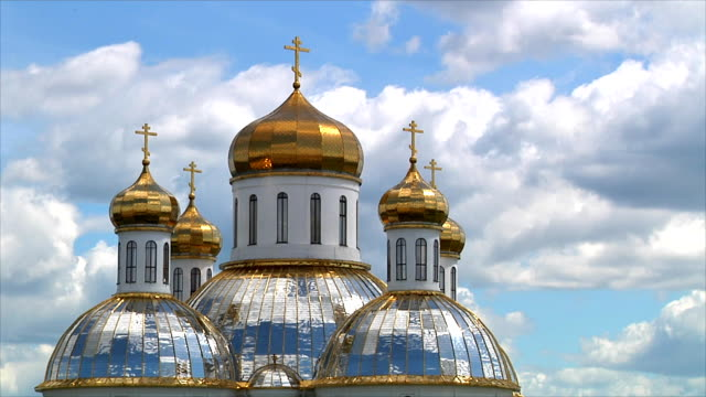 Golden domes of the Orthodox church against the sky and clouds. Time lapse. video