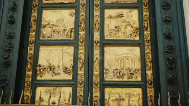 Golden doors with scenes from the Old Testament. Near Baptistry Duomo Santa Maria del Fiore, Florece, Italy video