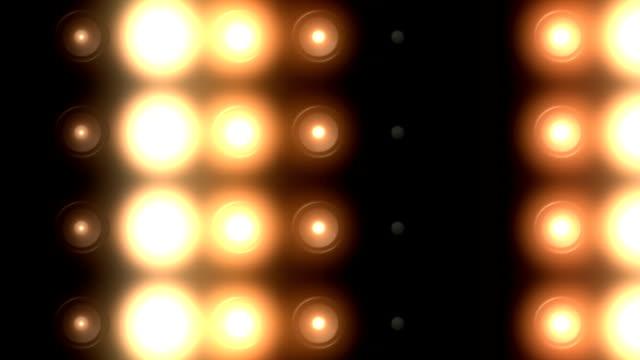 golden floodlights flashing in different variations. loop video