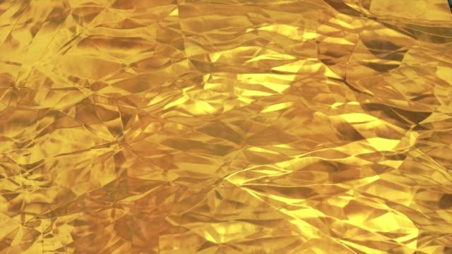 golden foil background. gold texture 3d rendering loop 4k - aluminum foil stock videos & royalty-free footage