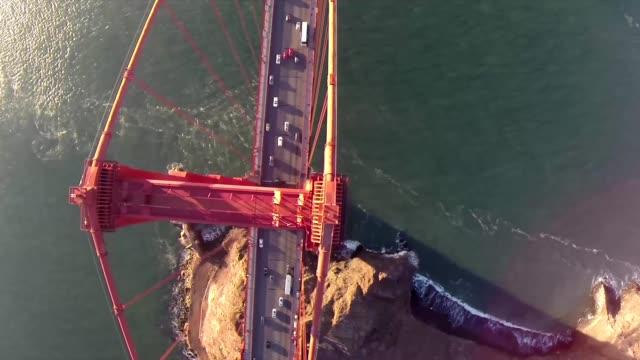 Golden Gate Bridge. Aerial shot of the Golden Gate Bridge in San Francisco on a clear, sunny day. Aerial view Golden Gate Bridge, San Francisco, USA - Aerial low level view Golden Gate Bridge vehicle traffic, Marin Headland, San Francisco, California, Nor